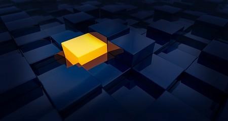 cubo iluminado entre cubos escuros